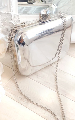 View the Elena Metallic Mirror effect Clutch Bag online at iKrush