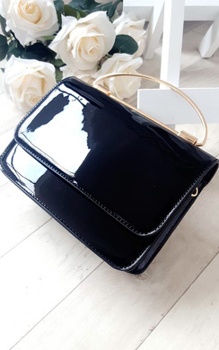 View the Elisha Patent Clutch Bag online at iKrush