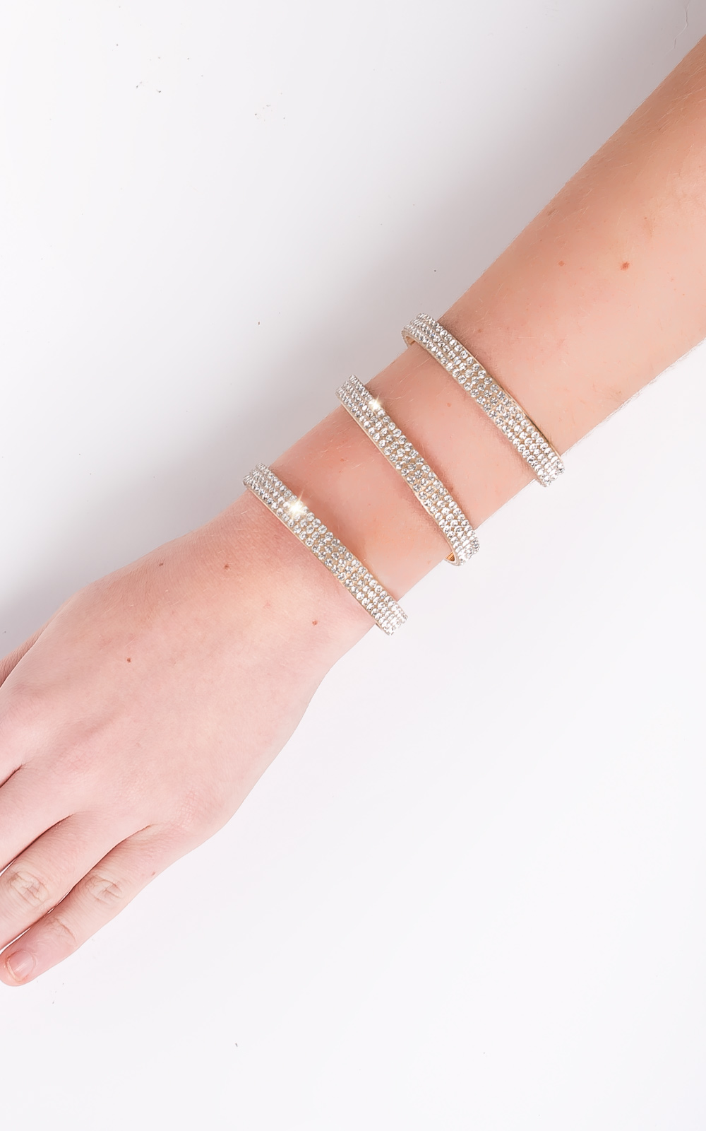 IKRUSH Womens Zoey Diamante Cuff This arm cuff is to die for! It features separate gold bands covered in diamantes. Pair this beaut with a bodycon dress for an amaze glam look!
