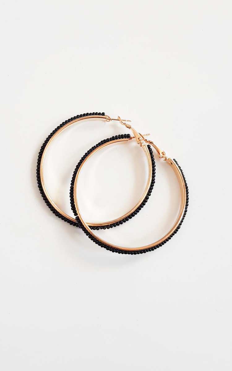 IKRUSH Womens Sonia Beaded Hoop Earrings our SONIA earrings feature gold plating  all over beaded design and loop clasp backing. Diameter is approx 2 BlackLoop Backing